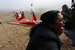 A woman reacts after it was announced that a drill reached the trapped miners at the San Jose Mine near Copiapo, Chile Saturday.