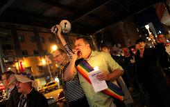 "People participate in Queer Rising's ""Take Back the Night"" gay rights march on Saturday in New York City. The march was organized following two hate crimes over the past week in NYC."