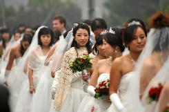 "Thousands of Chinese couples tied the knot throughout the country on the auspicious ""10/10/10,"" a day believed to bring good luck. American couples plan to do the same in droves."