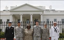 From left, Petty Officer Autumn Sandeen, Lt. Dan Choi, Cpl. Evelyn Thomas, Capt. Jim Pietrangelo II, Cadet Mara Boyd and Petty Officer Larry Whitt, stand together after they handcuffed themselves to the fence outside the White House in Washington during a protest for gay rights on April 16.