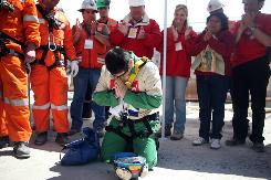 Miner Esteban Rojas, 44, gets on his knees to pray after becoming the 18th miner rescued at the San Jose mine near Copiapo, Chile.