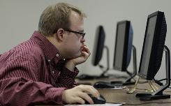 Gabe Savage works on a computer at Central Missouri State University in Warrensburg, Mo. Savage is participating in a two-year program at the school tailored to students with mental disabilities. 