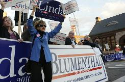 Political supporters for two U.S. Senate candidates -- Democrat Richard Blumenthal and Republican Linda McMahon -- rally Tuesday in New London, Conn.