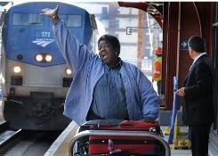 Business is up for Amtrak bag clerk Leita Andrews in Wilmington, Del.