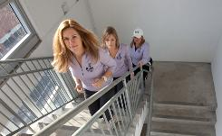 Onward and upward: Lindy Goss, left, Trista Kerr and Nancy Paridy train on the stairs of the municipal parking garage in Evanston, Ill., for next month's SkyRise Chicago.