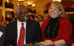 Supreme Court Justice Clarence Thomas sits with his wife, Virginia Lamp Thomas, as he is introduced at the Federalist Society in Washington in 2007.