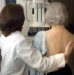 A technician in Lansing, Mich., prepares a patient for a digital mammogram.