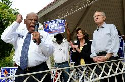Rep. John Lewis, D-Ga., supporter Damone Williams, Rep. Shelley Berkley, D-Nev., and Senate Majority Leader Harry Reid, D-Nev., rally supporters this week at Lorenzi Park in Las Vegas.