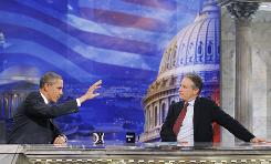 Jon Stewart, right, interviewed President Obama at a playhouse in downtown Washington, D.C.