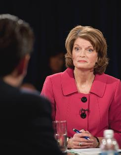 Sen. Lisa Murkowski awaits an answer from fellow Republican Joe Miller during a debate in Anchorage.