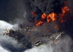 The Deepwater Horizon oil rig burns on April 21. Tests performed before the rigs deadly blowout should have raised doubts about the cement used to seal the well, U.S. investigators with the president's oil spill commission said Thursday.