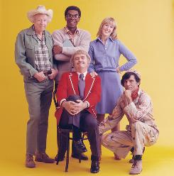 "James ""Jimmy"" Wall became the first black character on morning children's show  Captain Kangaroo in 1968. Other cast members: Hugh Brannum (Mr. Green Jeans), Bob Keeshan (the Captain), Debbie Weems (Debbie/Phoebe) and Gus Allegretti (the voice of Grandfather Clock)."