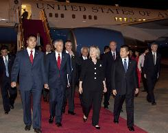 Secretary of State Hillary Rodham Clinton arrives at Phoenix International Airport in Sanya, China, on Saturday.
