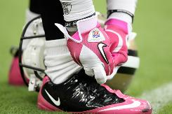 "The NFL has partnered with the American Cancer Society to promote breast cancer research and awareness. Some businesses, however, have used the practice of ""pinkwashing"" to profit from consumer concern about breast cancer, experts say."