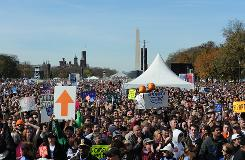 "Tens of thousands of people gathered on the National Mall on Saturday for the ""Rally to Restore Sanity and/or Fear"" organized by Jon Stewart and Stephen Colbert."