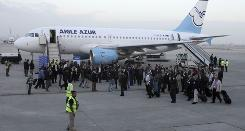 French business leaders leave the Aigle Azur plane after the airline's inaugural flight to Baghdad landed at Baghdad International Airport.