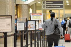 A passenger enters the security screening area at Hartsfield-Jackson Atlanta International Airport.