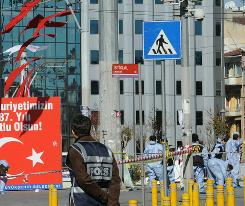 Police work at the scene of an explosion near tourist hotels and a bus terminal in Istanbul's Taksim Square.