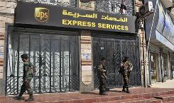 Security forces guard a UPS office in Sana on Sunday. Highly destructive bombs were sent from FedEx and UPS offices in Yemen, and addressed to synagogues in Chicago, officials say.