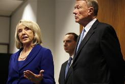 Arizona Gov. Jan Brewer, left, speaks at a news conference at a U.S. Circuit Court of Appeals building with attorney John Bouma, right, and Governor's office counsel Joe Kanefield, rear, in San Francisco, Monday.