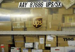 Parcels are ready for transport at the UPS distribution center at the International Cargo Airport in Cologne, western Germany, on Monday.