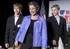 Sen. Blanche Lincoln, D-Ark., accompanied by her twin sons, Reece, left, and Bennett, 14, arrives on a platform to give her concession speech in her race for re-election Tuesday in Little Rock. Blanche lost her seat to Republican John Boozman.