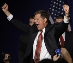 Ohio Governor-elect John Kasich celebrates at the state's party headquarters in Columbus after his election win.
