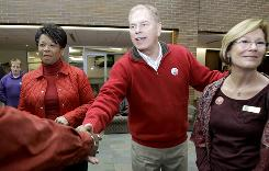 Democrat Lt. Gov. candidate Yvette McGee Brown, left, and Gov. Ted Strickland, center, greet a supporter Tuesday at the Tri-C Western Campus in Parma. At right is Tri-C employee Lois Osborn.