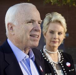 Sen. John McCain and his wife, Cindy, leave after voting at Madison Elementary School in Phoenix on Tuesday.