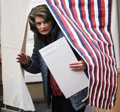 Lisa Murkowski emerges from a voting booth after filling out her ballot in Girdwood, Alaska. Murkowski is defending her Senate seat as a write-in candidate in a three-way race with Republican Joe Miller and Democrat Scott McAdams.