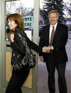 North Dakota first lady Mikey Hoeven leads her husband, Republican Governor of North Dakota John Hoeven, into a polling place in Bismarck, N.D. John Hoeven won his bid for the U.S. Senate.