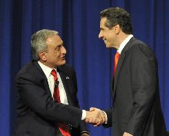 Republican candidate Carl Paladino shakes hands with Democratic candidate Andrew Cuomo before the 2010 New York State Gubernatorial debate held at Hofstra University in Hempstead, N.Y.