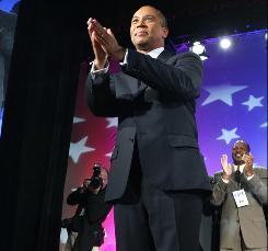 Massachusetts Democratic Gov. Deval Patrick celebrates his re-election at a victory party in Boston.