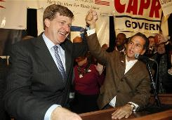 Rep. Patrick Kennedy, D-R.I., left, congratulates Providence Mayor and Democratic candidate for congress David Cicilline on his win for the 1st congressional seat of Rhode Island, Nov. 2, in Providence