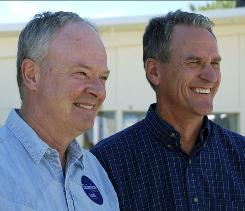 In this September photo, South Dakota Sen. Scott Heidepriem, D-Sioux Falls, left, and Republican Lt. Gov. Dennis Daugaard talk with organizers of a debate at the State Fair in Huron, S.D. Daugaard won their race for governor.