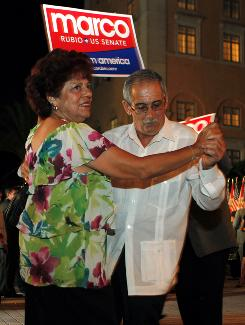 Ileana and Maximo Cruz of Miami hit the dance floor at Marco Rubio's victory party in Coral Gables, Fla.