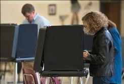 Voters in Centreville, Va., cast their ballots as elections in Virginia circle around U.S. House seats and state constitutional amendments.