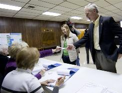 Republican senate candidate Ron Johnson arrives with his daughter Jenna to cast his ballot in Oshkosh, Wis., Nov. 2.