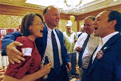 Republican Matt Mead celebrates with volunteer Kari Grey and his campaign manager, Bill Novotny, shortly after positive results from Campbell County were announced during his primary election party at the Little America in Cheyenne on Aug. 17. Mead was elected governor of Wyoming on Tuesday.