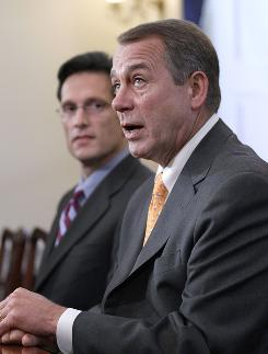 House Republican leader John Boehner, right, accompanied by House GOP Whip Rep. Eric Cantor, R-Va., talks about the changes in the balance of power on Wednesday morning.