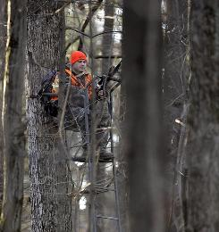 Delta Theta Sigma fraternity member Tom Kirby hunts for deer from a tree stand on Penn State University land in State College, Pa., in December 2008.