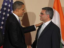 Bhupendra Khansagra of India's Spice Jet, right, shakes hands with President Obama as he holds a roundtable discussion with business leaders in Mumbai, India, Saturday.