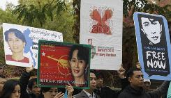 Activists hold pictures of pro-democracy leader Aung San Suu Kyi during a rally calling for her immediate release and a fair election in front of the Burma Embassy in Seoul on Sunday.