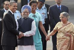 President Obama greeted Indian Prime Minister Manmohan Singh as first lady Michelle Obama was received by Singh's wife Gursharan Kaur on Sunday in New Delhi.