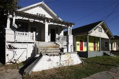 Abandoned lots and flood-wrecked homes remain a visible problem on New Orleans streets.