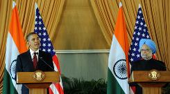 President Obama, left, delivers his speech as Indian Prime Minister Manmohan Singh looks on during a joint press conference at Hyderabad House in New Delhi on Monday. 