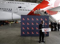 Qantas CEO Alan Joyce, seen here standing in front of an Airbus A380 in Sydney on Saturday, said Monday that engineers have discovered oil leaks in the turbine area of three engines on three different A380s.