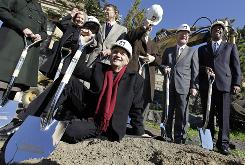 Architect Frank Gehry, holding shovel, attended Tuesday's groundbreaking for an underground expansion that he designed for the Philadelphia Museum of Art.