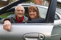 Charles Riley of Menlo Park, Calif., and his daughter Frances Riley Bright with Charle's car, a silver Taurus, in front of Frances' home in Millbrae, Calif. The number of older drivers in the USA is rising rapidly.