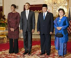 President Obama and first lady Michelle Obama pose for a photo with Indonesian President Susilo Bambang Yudhoyono and his wife, Ani Yudhoyono, at State Palace Complex Istana Merdeka in Jakarta on Tuesday.